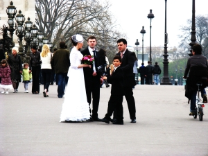 wedding party taking photos on Pont Alexander III