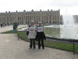 posing in front of Versaille with the Daily Pilot